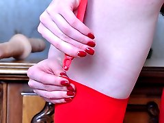 Brightly dressed girl spread-eagles in her red nylons for hot dildo fucking