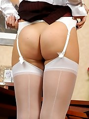 Raunchy sec stretching her white back seam stockings before putting them on