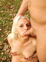 Sexy blonde grandma Szandra goes for outdoor fucking and got her cooter fucked hard after...