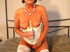 Horny mature slut playing with her toy
