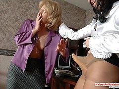 Nasty lady-boss seducing her mature secretary and getting hot pantyhose sex