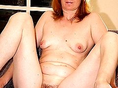 Ginger mom shows her boobs and stretches her pussy