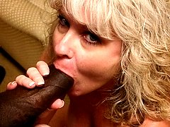 MILF babe stuffing her mouth with a black meat stick