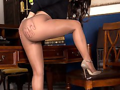 Petite but busty Estelle looks perfect to adorn any office in her short tight mini skirt, high...