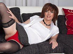 Horny housewife playing on the couch