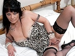 This kinky mature slut playing with herself