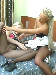 Curious gal getting a glimpse into barely black pantyhose of her girlfriend