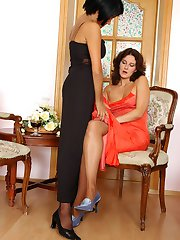 Classy milf in black hose seducing her female friend with freaky tongue job