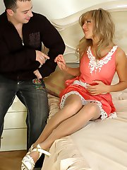 Leggy hottie putting on grey hose and going for doggie with nylon crazy guy