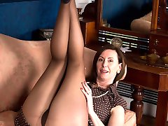 Blatantly kinky, Lara gets her hands inside the sheer warm nylon to spread and frig her wet...