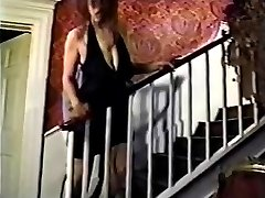 Big Tit girl on stairs with white stockings