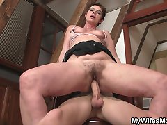 The hairy hole of a pretty mama eats up a young stud039s massive erection.