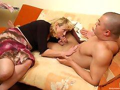 Leggy mature gal wakes up a sleepy stud taking advantage of his big hard-on