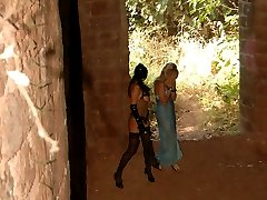 Cutie in blue lingerie gets her ass punished by a merciless cat lady in the old castle ruins