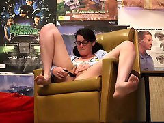 Amateur girl with glasses toys her hairy vag