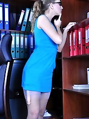 Spectacled office girl takes a dildo out of her grey stocking for solo anal
