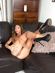 Heres Natalia in a pair of shiny sheer pantyhose, high class designer heels and a clingy mini...