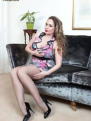 Sophia is gagging to exhibit her charms as she poses provocatively in sexy sheer pantyhose!