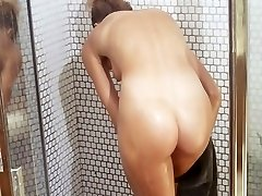 Blonde in a Bathroom Having a Shower with Soap Bubbles All Over
