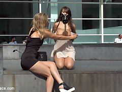 Mona Wales has found another eager little nympho who needs to be publicly fucked and degraded. Naked and exposed Nikki Litte begins her Public Disgrace as a public ashtray. Tramping up and down a courtyard, Nikki pleads with every smoker she can find to use her.  In exchange for their ash she spreads her legs, giving anyone a peek at her excited cunt.  Mona then takes her enthusiastic attention whore to the boardwalk. Nikki's Barefoot, bare pussy and bare ass illicit many reactions from the passing crowd.  Some stare with disgust while others stop in their tracks to watch Nikki's perky little titties bounce as she skips on by.  After Mona is satisfied with Nikki's public display she takes her little slut to the closest bar to see if she can find some cocks to pound Nikki's cunt.  As soon as Mona and Nikki walk into the bar the flies go down and the dicks get up.  Nikki gets to work and wraps her tits around a cock, jerking the tip directly into her mouth.  It isn't long before Nikki is bent over a table getting her cunt pounded as everyone in the bar gropes her breasts and grabs her ass.  Once thoroughly used up, Nikki finishes the throbbing cocks with her throat.  Slurping their balls till they unload all over face and into her gaping mouth.  Mona smiles, content with her work.
