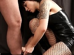 Femdom Nightshadow has a helpless victim bound to a post with his legs spread wide. He cant do...