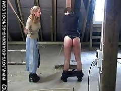 Guy gets pants down caning in the attic from viscious bitch