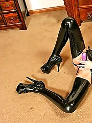 Tall long-legged strapon girl performs her skinny body in latex and rubs a dildo