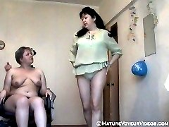 Dressing and naked moms caught on voyeur tape