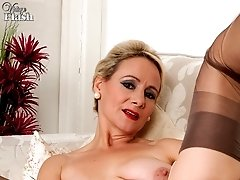 Mature Tiffany teases in her sheer panties and coffee full fashion nylons