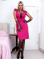 Black stocking clad Lucy Zara uses her big crystal dildo on the bed