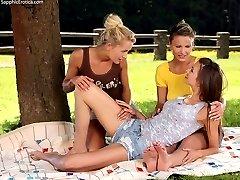 Gorgeous vixens in garden threesome