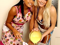 Two cute girls eating pussy in the kitchen