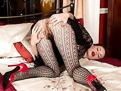 Mystique with legs, long lacy pantyhosed ones sporting a very exotic look...