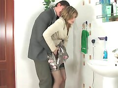 Voluptuous female co-worker in gorgeous stockings gobbling on meaty pole