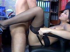 Exotic office babe in six-strap garter stockings getting nailed on the desk