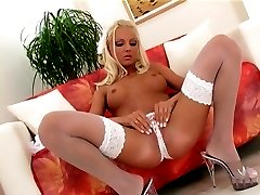 Sexy blonde babe in white panties and thigh high stockings