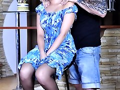 Long-haired brunette opens up her legs in black nylons for a tattooed stud