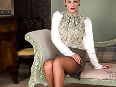 Vanessa is teaching about 50's fashion in her full cut panties, deep garters, pencil skirt, stilettos and tan fully fashioned sheer nylons.