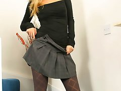 Saucy secretary Hayley-Marie in a revealing outfit with patterned grey pantyhose and kinky black...