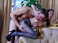 Long-legged girl in dark-blue fashion pantyhose getting it on with her guy