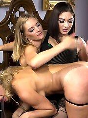 A sadistic lesbian couple, Mona Wales and Lea Lexis, keep beautiful kitten, Cherie Deville, as a...