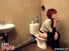 Guilty red haired doll spanked in the toilet