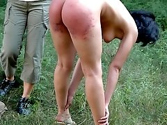 Teen bitch gets her ass spanked on green grass