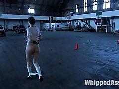 Maitresse Madeline storms into the green room, grabs Kristine and parades her around the armory...