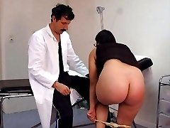 Exposed large bottom brutally spanked red in the examination room