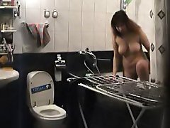 Busty milf takes a shower unsuspecting of cams