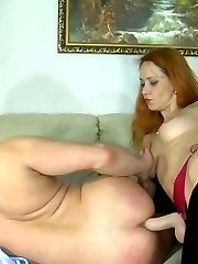 Pervy redhead gives head before hiking her skirt and ramming her guys ass
