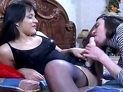 Sexy brunette takes out a strapon cock for her pussy guy to suck and fuck