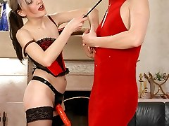 Sissy worker fitting on a gown before getting nailed by strap-on armed babe