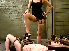 Training Goals: Focus, Fortitude and Service  Training Strategies:  stress position while drilling the applicant on his motivations to train. Separate mind from body using high heels, pain and a chance to  lend oneself. Separate ego from action with a hard strap on cock.   Strip dignity and provide opportunity to demonstrate devotion. Send him away to prepare tribute and return in one week.